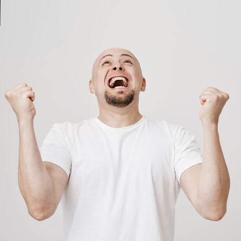 bald men screaming from happiness