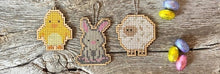 Load image into Gallery viewer, Bunny cross stitch shown with chick and sheep cross stitch, which are also available as kits on the same website