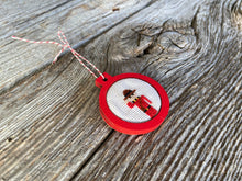 Load image into Gallery viewer, Mountie ornament in red wood frame