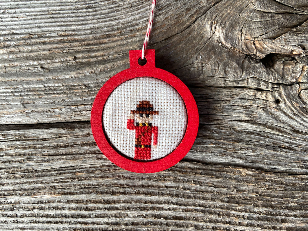 Mountie ornament in red wood frame