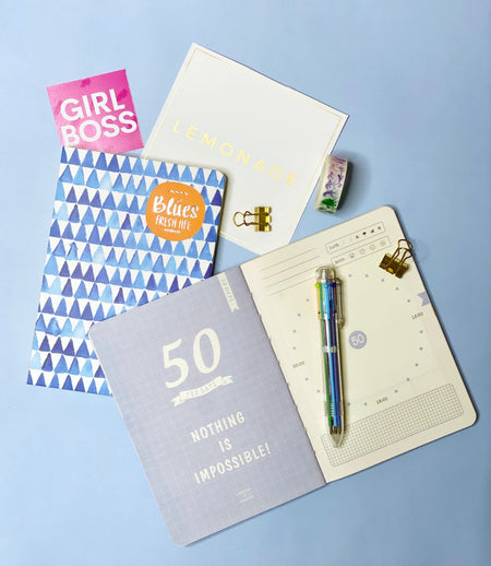 100 - Day Goal Notebook With Multicolor Pen & Washi Tape - Blue Aztec-Description: Accomplish all your goals one day at a time with this 100 - Day Goal Notebook by Lemonade. It helps you outline exactly what you want to achieve, lets you track your progress & reflect on your success. With this motivational journal complete your required tasks & achieve discipline, productivity & focus. Perfect for a hardworking student, aspiring entrepreneur or even someone who wants to build a habit. You'll eas