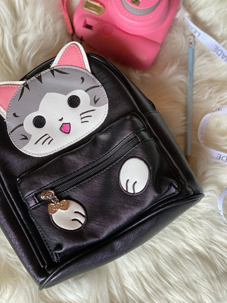 Backpack Cute Kitty - Black-Description: New favorite go-to backpack crafted from durable PU Leather. A classic silhouette with two compartments as well as a hidden back zipper and a cute keyring. Find it only at Lemonade. Dimensions: 9.5 x 3 x 8.5 InchesSold individually.-Default Tittle-LemonadeIndia