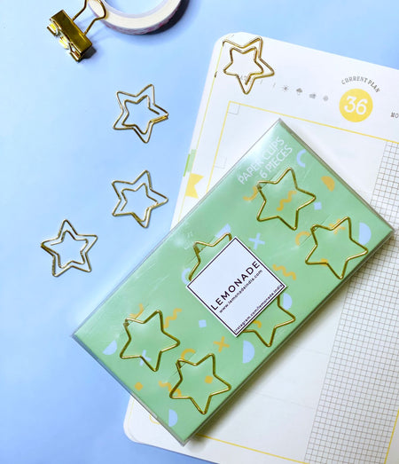 Bookmark/Paper Clips Set of 6 - Shining Star - Gold-Description: Use these Shining Star Paper Clips by Lemonade to brighten up your daily planners and organizers. They can also be used as calendar markers, bookmarks, scrapbooks, or anywhere you need some fun! A great gift for all stationery lovers!These clips are a great way to also clip & organize all your post-its and doodles in one place. Now off you go to declutter your office space in a stylish way! Dimensions: H - 0.8 inches approx Materia