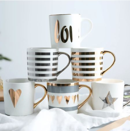 Coffee Mug - Love - Gold-Description: Love your mugs just as much as coffee? This one's for you! Made from high-quality ceramic, this super chic gold foil Love Coffee Mug from Lemonade is all you need for your morning cuppa! This coffee mug makes a great gift for all the coffee lovers out there. It makes the perfect Secret Santa present for your colleagues, grab one for you & your BFF, hurry! Dimension: H - 8.6 cms, W - 8.9 cms Material: Ceramic Capacity: 350 ml approx Weight: 260 gms Sold Indiv