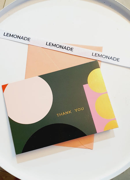 Greeting Card - Thank You-Description: Every Thank You greeting card by Lemonade has a unique design & comes with a colourful envelope. It has a Paper UV Finish with a gold foiling effect. These thoughtfully designed notecards are perfect to convey appreciation or to say thank you for being there etc. It has a dedicated space where you can write your own personal message for a personal touch for that special person. So hurry, grab these before they're gone! Sold Individually. Color of Envelope: