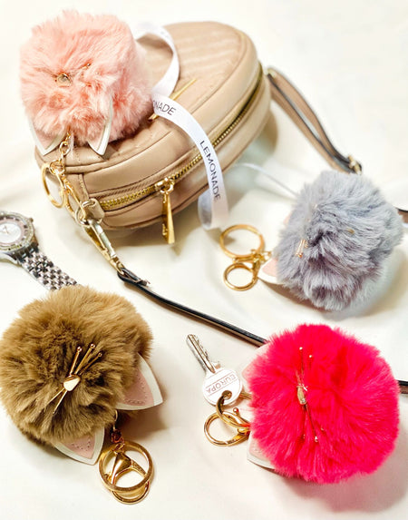 Kitty Fur Ball Keychain-Description: Add a pop of color + quirk to your boring keys with this adorable Kitty Fur Ball Keychain from Lemonade. This keychain is a great way to hold all your keys together in an organized manner plus makes a fantastic bag charm. Sold Individually. Dimensions: 3.5 Inches × 3.5 Inches approximately-Hot Pink-LemonadeIndia