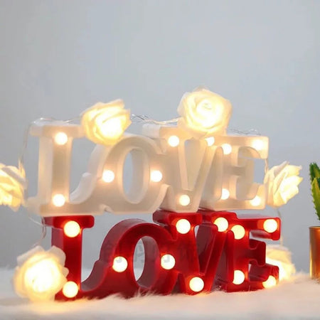 LED Love Light-Description: This Love Light by Lemonade brightens the room just enough to ensure the light is just right! You can replace the boring desk lamp and add color to the darkest room with these lights. This unique design is an ideal decor piece to create a beautiful installation by pairing it with other decor items or add to your party, any room in your house or you can even hang it on the walls. You can even just rest it on a shelf, table or your dresser. Requires 2 AAA batteries whic