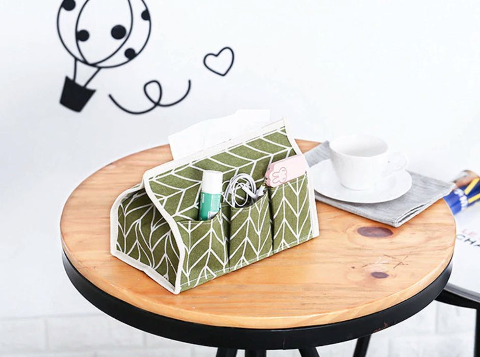 Tissue Box Organizer - Green-Description: This multi-purpose Tissue Box Organizer by Lemonade is made of natural cotton & linen. This stylish tissue box can be used in a restaurant, office, household & even a vehicle.It helps you declutter your storage space, organise your belongings & serves as a great decor item in any room!It's very portable and small & is made with a dust resistance material making it super easy to clean.Save your space when not in use, you can fold & keep it away. Sold Indi