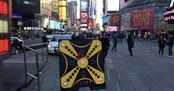 The KOOBA game board stands proudly in the bright lights of Times Square in New York City.