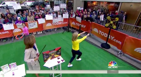 TODAY show toy expert Meredith Sinclair aims her shot at the KOOBA board while Hoda looks on in the plaza.