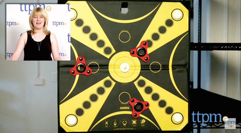 A screen-shot of the video review shows a close-up of the KOOBA board with the reviewer in the top left corner.