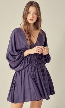 This dreamy midnight color dress features an elastic tie in the front and back at the top of the dress, adding a nice touch. The super soft and comfortable feel makes this adorable dress a must have.   SELF: 100% POLYESTER, LINING: 100% RAYON