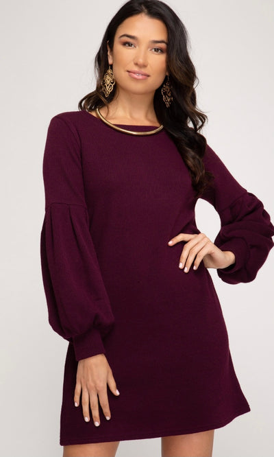 Style may run small, we suggest sizing up. No lining. Imported. Eggplant stretchy ribbed knit self. Rounded neckline. Long lantern sleeves. Straight hemline. Self: 85% Polyester, 10% Rayon, 5% Spandex.