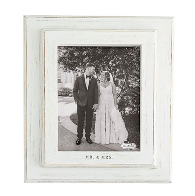 "Display the perfect wedding day photo with the ""Mr. & Mrs."" Picture Frame by Mud Pie. Featuring a layered white washed wood frame with a crisp mat with ""Mr. & Mrs."" printed on the bottom for an elegant touch. Photo Size 8x10"
