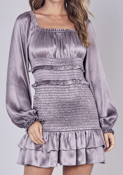 This silver grey, purple smocked dress is a must have!  100% Polyester
