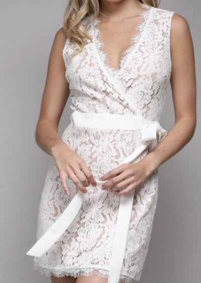 This white lace wrap dress with white bow tie at the waist is perfect for all all special occasions!