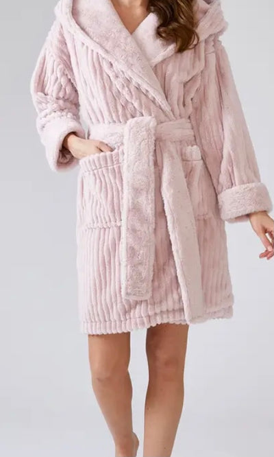 We called it the Cloud Robe for a reason. Imagine slipping into this beautiful nightwear robe on a cold winter's night and drifting away into dreamland. A luxury textile lining and oversized hood give this dressing gown added cosiness. Rachel, our lovely model, didn't want to take it off. Available in S/M and M/L in Pink and Cream.