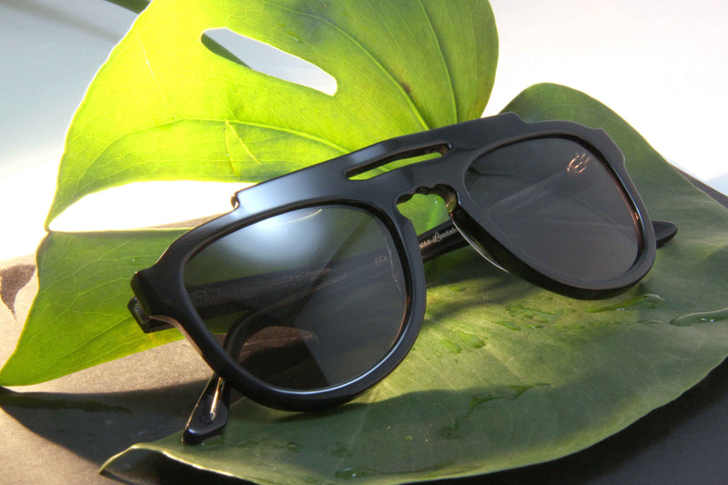 Black Steluda Polarised Sunglasses Made In Australia On Green Leaf