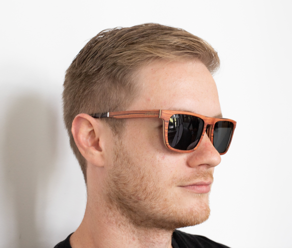 male model wearing Daintree wooden polarised sunglasses