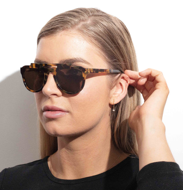 Female model wearing Australian Made Steluda Polarised Sunglasses