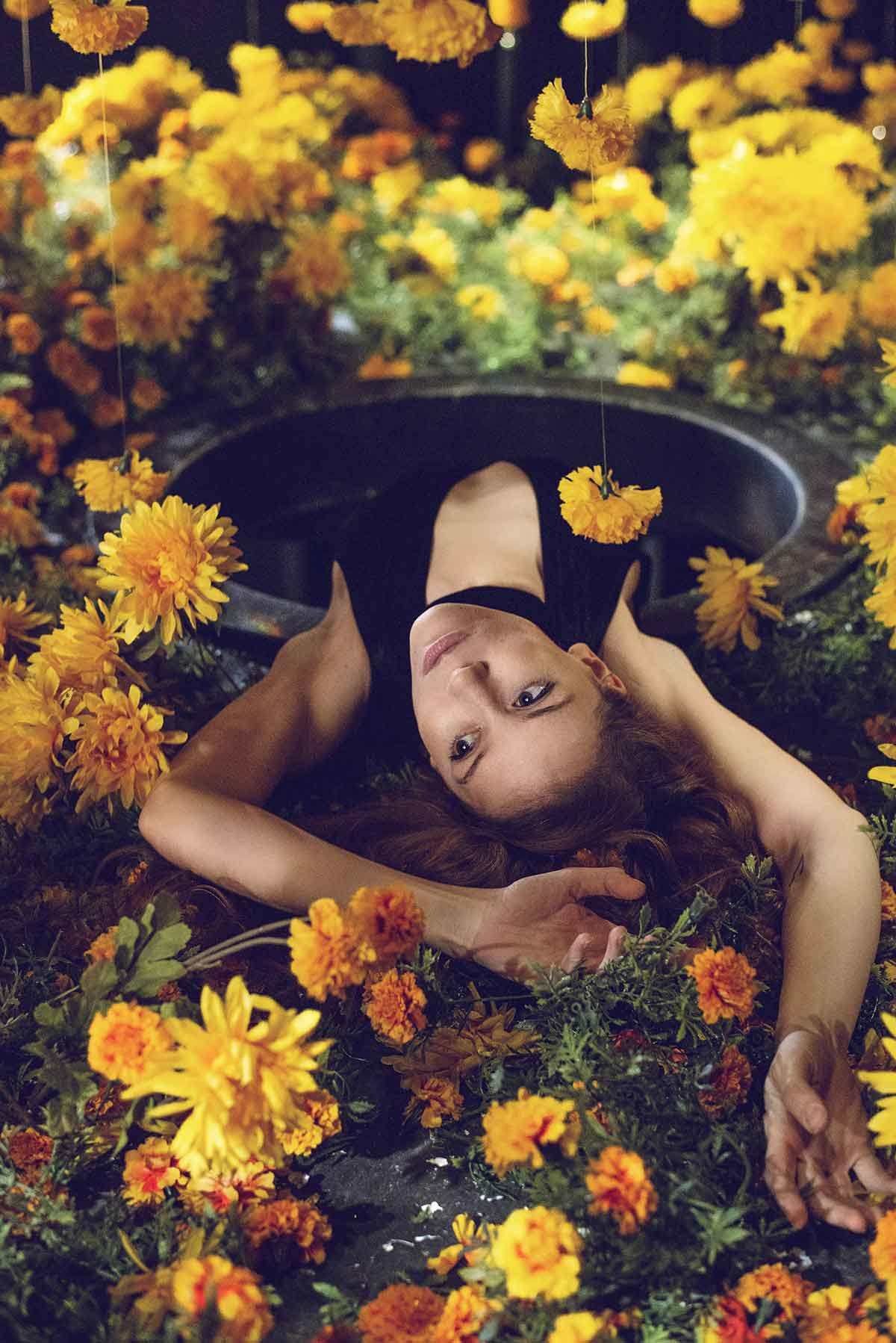 women laying in marigolds