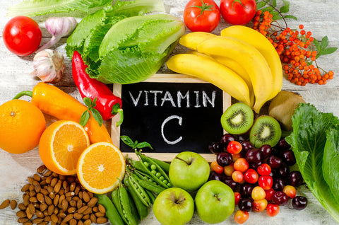 Foods High in vitamin C on a wooden board