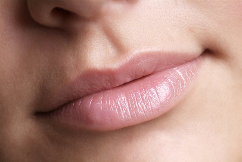 detail of a pink made up lip and nose