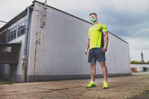 Man in running outfit wearing a fabric face mask