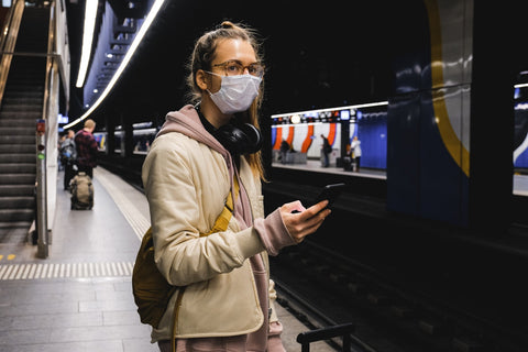 Woman on subway wearing air filter mask