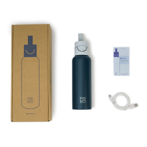 The REBO package includes a REBO Smart Bottle with Smart Cap, quickstart guide, usb type C charging cable and a recycled cardboard box