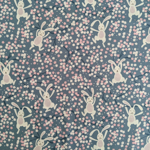 Swinging bunnies on denim blue - 100% cotton - Lewis and Irene