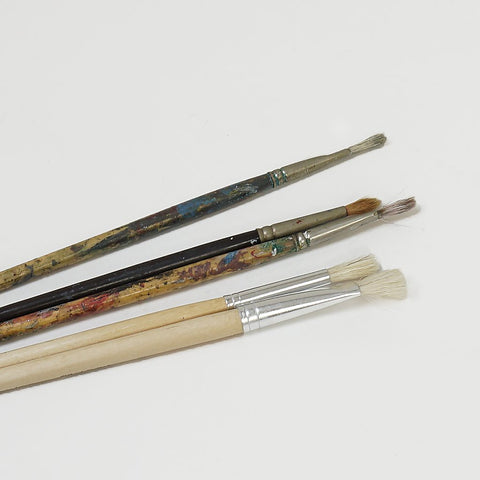 Five assorted paintbrushes