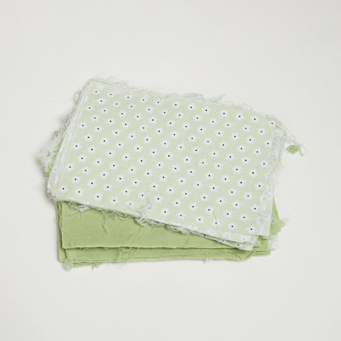 Assorted green fabric squares