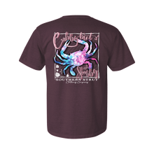 "Load image into Gallery viewer, Printed on a Comfort Color wine colored t-shirt the crabby not shabby design is a psychedelic crab with ""Crabby but"" above the crab and ""Not Shabby"" below, both in light pink script."