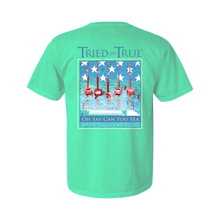 Load image into Gallery viewer, Printed on a Comfort Color seafoam colored t-shirt, the Oh Say Can You Sea, an Americana themed, design is an off shore theme of a an offshore boat in the middle of sea with a blue back ground with white stars and red reels on the back.
