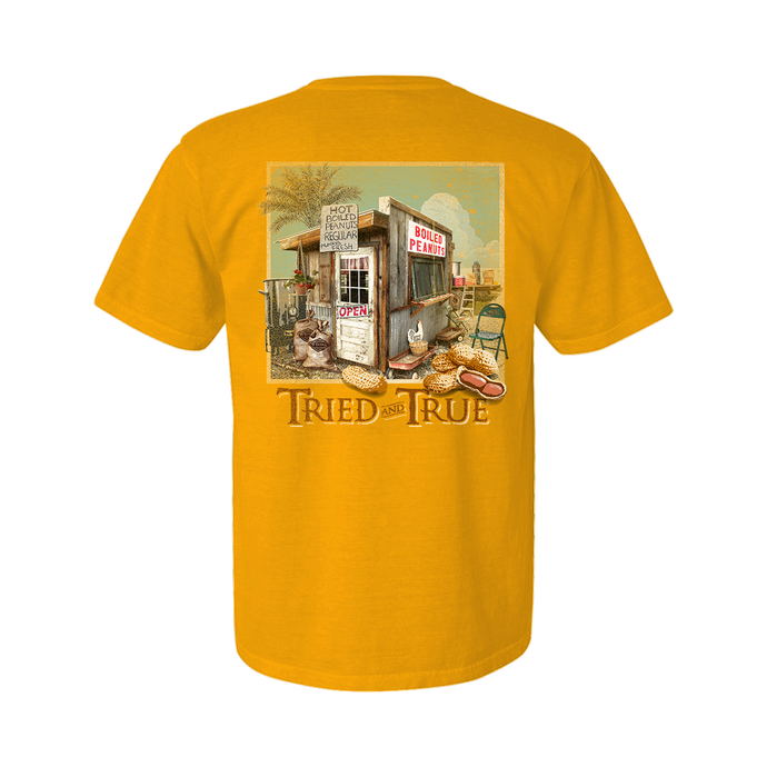 Printed on a Comfort Color Citrus dyed t-shirt. The design is a framed boiled peanut scene with the peanut shake in the middle.