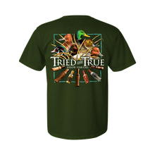 Load image into Gallery viewer, Printed on a Comfort Color hunter green t-shirt. The duck call shirt has an assortment of ducks head: mallard, wood duck, canvasback, red head, and pintail above a collection of wooden Calls.