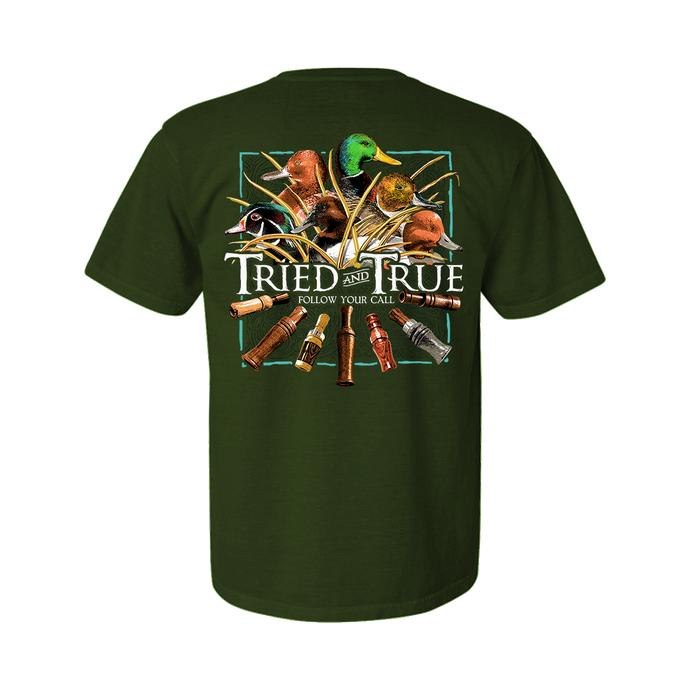 Printed on a Comfort Color hunter green t-shirt. The duck call shirt has an assortment of ducks head: mallard, wood duck, canvasback, red head, and pintail above a collection of wooden Calls.