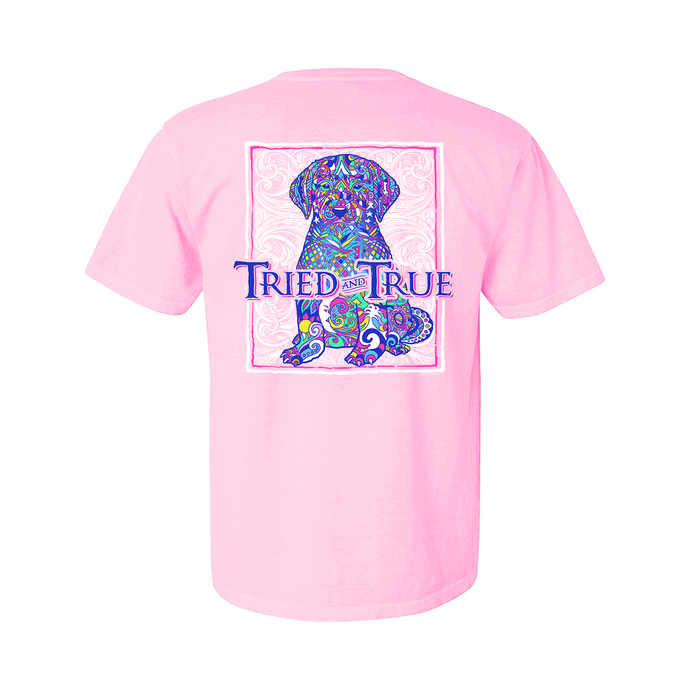 Printed on a Comfort Color blossom colored t-shirt and part of our mosaic collection, the cute mosaic puppy really pops with all its vibrant colors in front of a white Tried & True signature wave background.