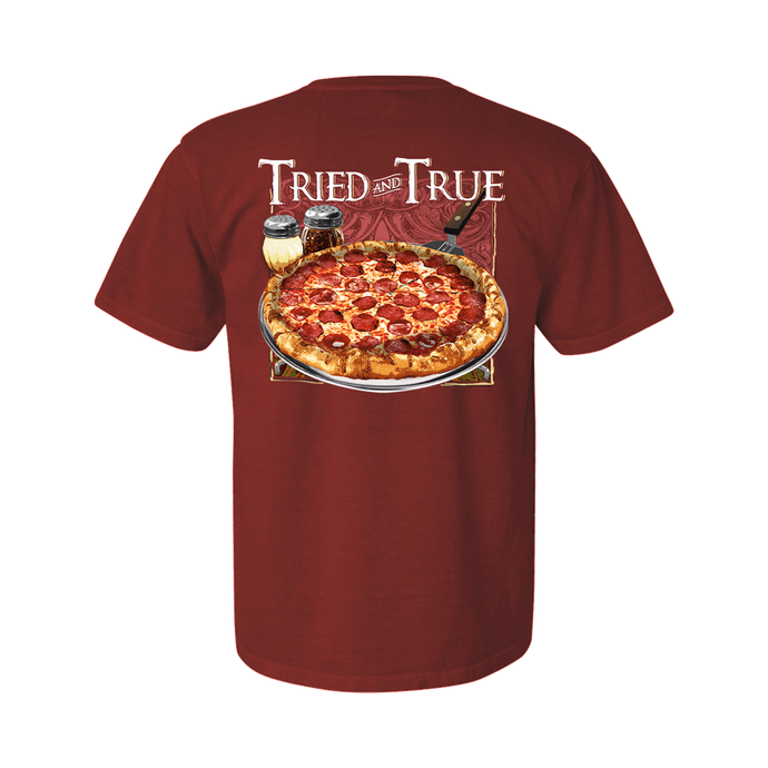 Printed on a Comfort Color crimson colored t-shirt and part of our menu collection, coming to life as if it just came out the oven the pizza design has a nice brown, yellow, and red pepperoni pizza as the main focus. With parmesan and pepper to the back left corner and the Tried & True signature waves in the background.