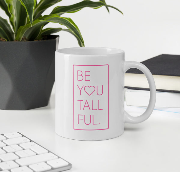 White coffee mug with pink font