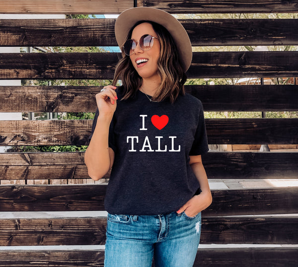 "Model wearing an ""I Heart Tall"" t-shirt design."
