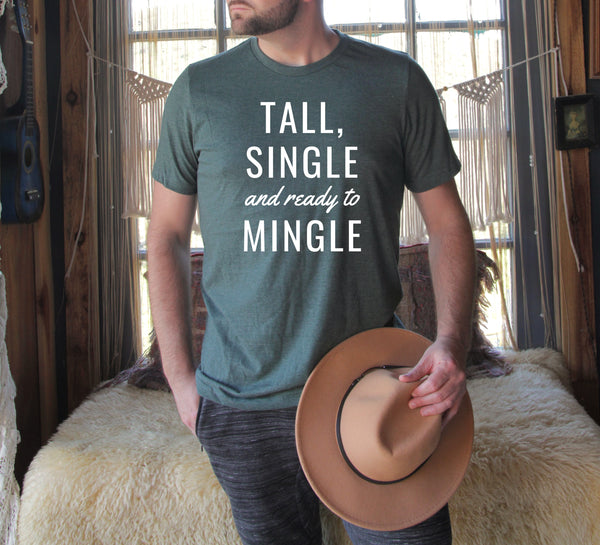 "Man wearing a ""Tall, Single and Ready to Mingle"" t-shirt."
