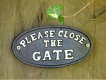 Please close the gate Black cast iron sign