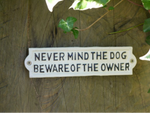 Never mind the dog beware of the owner cast iron sign