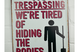 No Trespassing tin sign