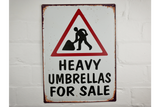 Heavy Umbrellas for sale tin sign