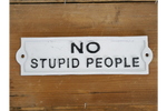 No Stupid People cast iron sign