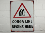 Conga Line Begins Here tin sign