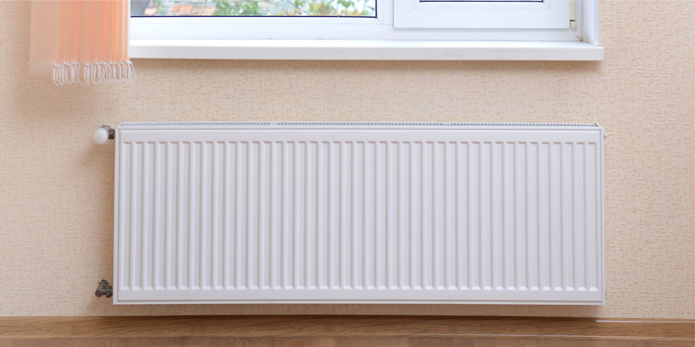 Why are radiators traditionally under windows